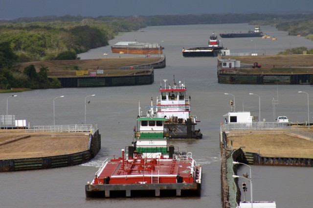 Barges transit through the Colorado River Locks near Matagorda, Texas, July 17, 2013. Navigation systems across the country, such as the Colorado River Locks, significantly contribute to the growth and economic prosperity of the nation. The Colorado River Locks alone, enable the transit of more than 12,000 tows, more than 30,000 recreational or commercial vessels, and 20 million tons of product annually, providing an essential service that significantly impacts local communities, the state and the nation's economies.