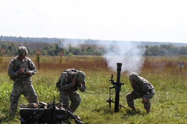 "FORT CAMPBELL, Ky., - Soldiers assigned to mortar platoon, Headquarters, Headquarters Company, 3rd Battalion, 187th Infantry Regiment, 3rd Brigade Combat Team ""Rakkasans,"" 101st Airborne Division (Air Assault), fire a 81mm mortar during a field training exercise at Fort Campbell, Ky., Sept. 17, 2013. The mortar teams worked in unison with forward observers to increase their proficiency during the FTX. (U.S. Army Photo by Spc. Brian Smith-Dutton, 3/101 Public Affairs)"