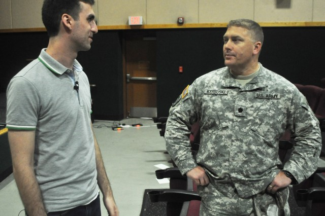 Jack Reitz, trainer with the sex signals program, and Lt. Col. Pat Kerbuski, deputy G-1 officer with Eighth Army, spoke about how the training raises the awareness and prevention of sexual assault and harrassment after sex signals skit given to the service members of USAG Yongsan.(U.S. Army photo by Sgt. Kevin Frazier)