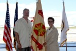 Ronald Chronister and Debra Zedalis pose with newly uncased IMCOM-P flag