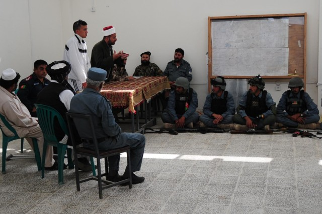 The Imam of the Jordanian Engagement Team speaks to the leaders and patrolmen of the local Afghan Uniformed Police about the importance of the elections and freedom of thought at the Tani District Center, Afghanistan, Oct. 1, 2013. (U.S. Army photo by Staff Sgt. Todd A. Christopherson, 4th Brigade Combat Team Public Affairs)