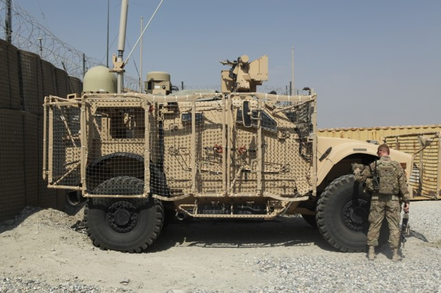 A Solider checks a Warfighter Information Network-Tactical, or WIN-T Increment 2 Point of Presence-equipped vehicle at Forward Operating Base Gamberi, Afghanistan, in September 2013.