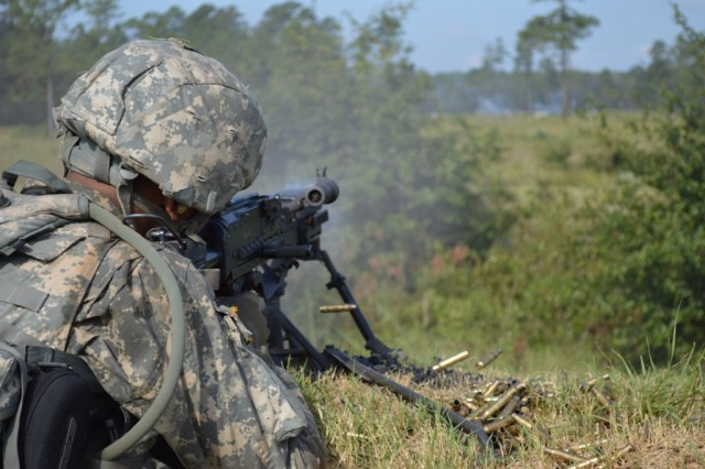 A M240B gunner with the 48th Infantry Brigade Combat Team, aims at an objective during a situational training exercise at Fort Stewart, Ga. The National Guard unit is training under the tutelage of 188th Infantry Brigade trainer/mentors.