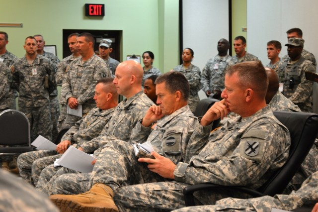 Gen. Daniel Allyn, commander of U.S. Army Forces Command, sits in on a 48th Infantry Brigade Combat Team combined arms rehearsal, with Lt. Col. Randall Simmons, brigade commander. During the brief, Allyn expressed his appreciation at the brigade preparedness for the eXportable Combat Training Capability exercise, and fielded questions from those in attendance.
