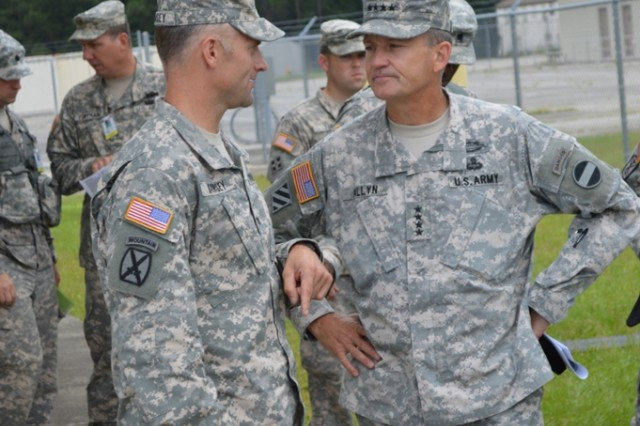 Col. Christopher Ramsey, commander, 188th Infantry Brigade, First Army Division East, and Gen. Daniel Allyn, commander, U.S. Army Forces Command, talk after a combined arms rehearsal. Ramsey's brigade provided embedded trainer mentors to the 48th Infantry Brigade Combat Team, a National Guard brigade out of Macon, Ga.