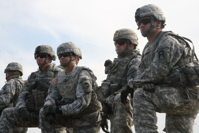 The Commander of Forces Command, Gen. Daniel Allyn (center) watches multi-component, integrated training with the Georgia National Guard's 48th Infantry Brigade Combat Team commander, Col. Randall Simmons, on his right, and First Army Division East's 188th Infantry Brigade Commander Col. Christopher Ramsey, on his left.