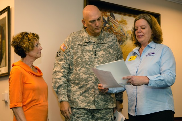 Mrs. Linda Odierno, Army Chief of Staff, Gen. Raymond T. Odierno, and Kara Dallman from the United Through Reading Program discuss the book Otis on Oct 3, 2013, at the Pentagon, Washington D.C.