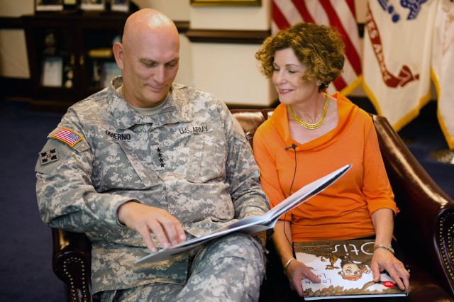 Army Chief of Staff, Gen. Raymond T. Odierno, and Mrs. Linda Odierno, read the book Otis in celebration of Jumpstart's Read for the Record at the Pentagon, Washington D.C., on Oct 3, 2013.