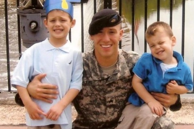 Staff Sgt. Michael H. Ollis poses with his nephews when he was a sergeant. He is remembered as a hero and is being honored with the Silver Star and Poland's Armed Forces Gold Medal for his actions that saved the life of a Polish officer in Afghanistan.