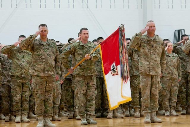 Soldiers of Headquarters and Headquarters Company, 555th Engineer Brigade, render salutes while the band plays the national anthem during a homecoming ceremony at Wilson Sports and Fitness Center, Oct. 4. The 555th Engineer Bde., HHC, completed a nine-month deployment to Afghanistan in support of Operation Enduring Freedom.