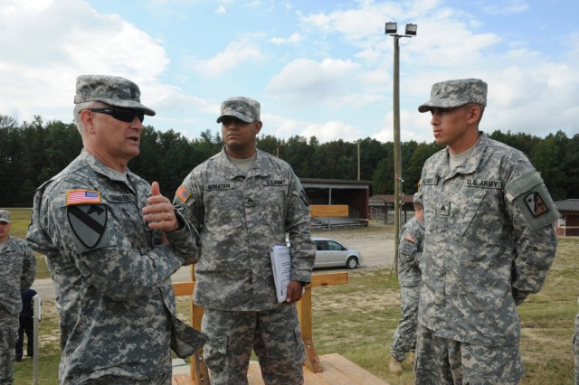 Sgt. Maj. of the Army Ray Chandler discusses Best Warrior Competition  plans on a Fort Lee, Va., range with Sgt. Justin Morataya and Sgt. Moises Alfaro, Sept. 27, 2013.