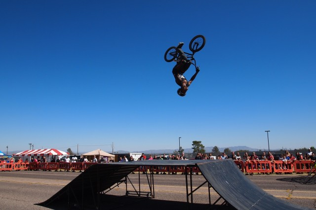 """Isaac McNeal from Brigade FMX World Wide Extreme Motorsports performs """"BMX Freestyle Jumping"""" at the """"Bikes and Bands"""" Street Fair Saturday. McNeal was one of four motorsport riders to show gravity-defying stunts."""
