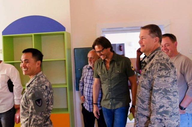 In Bosnia, Maj. Marc Nguyen (left), contracting officer, 409th Contracting Support Brigade, meets with representatives from the Glamoc School in Sarajevo, to discuss facility improvements. The school, which caters to special needs children, is part of a humanitarian assistance program through the U.S. European Command.