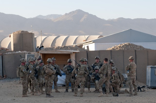 U.S. Army Soldiers from Company A, 3rd Battalion, 7th Infantry Regiment, 4th Infantry Brigade Combat Team, 3rd Infantry Division, conduct a briefing before a mission rehearsal at Combat Outpost Sultan Khel, Wardak Province, Afghanistan, Oct. 6, 2013. The rehearsal covered tactics and protocol for upcoming foot patrols. (U.S. Army National Guard photo by Sgt. Margaret Taylor, 129th Mobile Public Affairs Detachment/RELEASED)