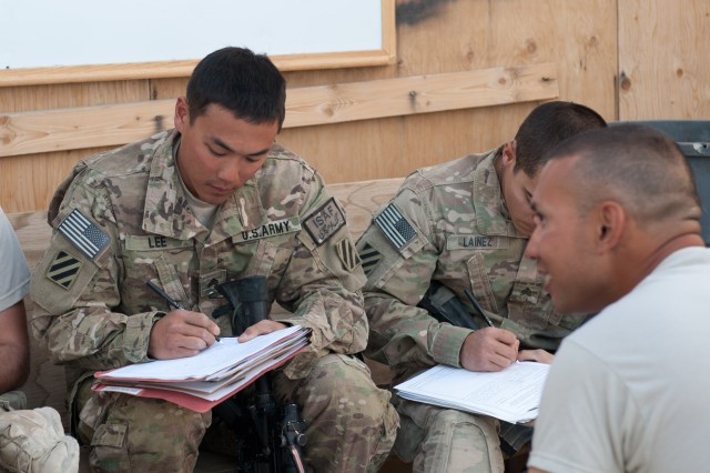 U.S. Army Sgt. Christopher Lee, of Los Angeles, Calif., a team leader with Company D, 3rd Battalion, 15th Infantry Regiment, 4th Infantry Brigade Combat Team, 3rd Infantry Division, completes administrative paperwork at the end of the workday at Combat Outpost Sultan Khel, Wardak Province, Afghanistan, Oct. 6, 2013. (U.S. Army National Guard photo by Sgt. Margaret Taylor, 129th Mobile Public Affairs Detachment/RELEASED)