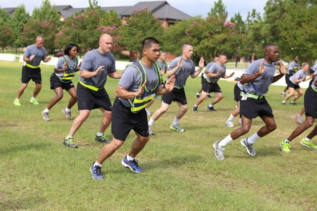 Master fitness trainers get some exercise instruction.