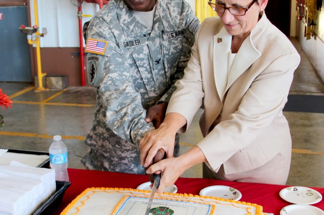 Col. Nestor Sadler, U.S. Army Garrison-Kwajalein Atoll commander and Debra Zedalis, director of U.S. Army Installation Management Command Pacific Region, cut the cake after the uncasing ceremony.