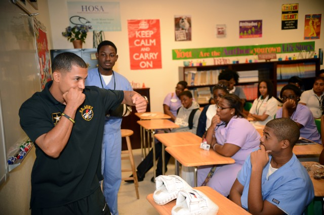 U.S. Army World Class Athlete Program assistant boxing coach Staff Sgt. Alexis Ramos demonstrates a punching sequence to a class at North Miami (Fla.) Senior High School during a recruiting visit during National Hispanic Heritage Month.