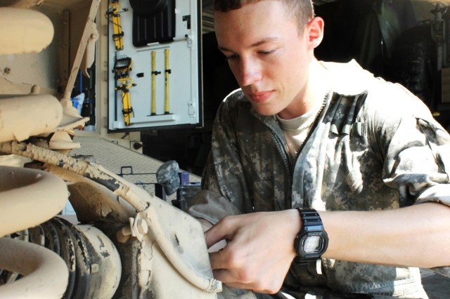 Pfc. William Denton, a light wheeled mechanic from Austin, Texas, repairs a tire hub on an M1121 Humvee Oct. 3 at the Mansfield Motor Pool on Fort Knox, Ky. Denton, a mechanic with the 201st BSB, 3rd IBCT, 1st ID, helps his unit maintain, service and repair approximately 400 pieces of equipment.