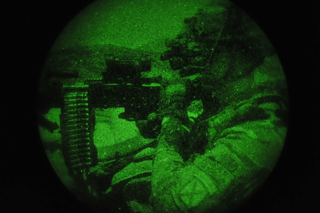 Pfc. Justin Singleton, an infantryman with 2nd squad, 3rd Platoon, Company C, 2nd Battalion, 30th Infantry Regiment, 4th Brigade Combat Team, 10th Mountain Division, and a native of Deland, Fla., uses his night vision devices as he mans his M240 machine gun while standing guard on a night observation post on Forward Operating Base Torkham, in Nangahar Province, Afghanistan, Sept. 27, 2013.