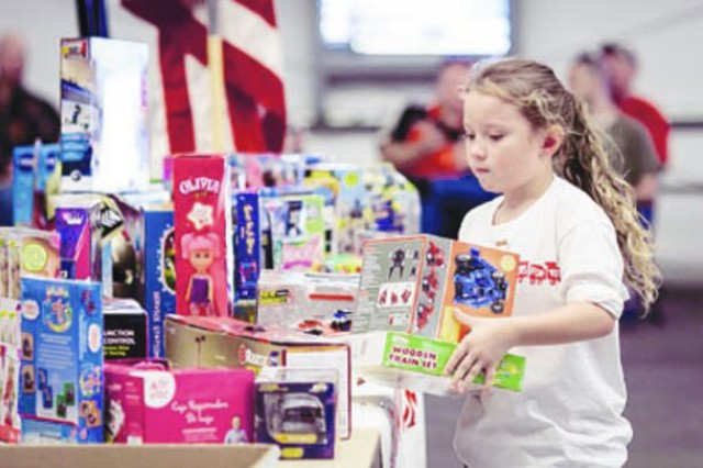 Dani Kallas, 7, organizes donated toys during Saturday's second annual Toys for Tots Motorcycle Run at the Pavilion. The event was the official kickoff of the 2013 toy drive sponsored by the Marine Corps. (Photo by Nate Pesce)