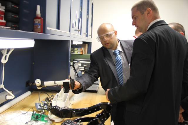 Polish scientists examine robotics at a U.S. Army Edgewood Chemical Biological Center facility at Aberdeen Proving Ground, Md., Oct. 2.