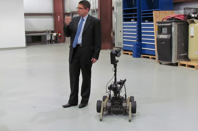 A Polish scientist demonstrates a robot at a U.S. Army Research Laboratory facility at Aberdeen Proving Ground, Md., Oct. 3.