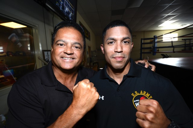 """Rafael Ramos, a retired Army first sergeant and member of the Puerto Rico Boxing Hall of Fame, and son Staff Sgt. Alexis Ramos, a three-time All-Army and Armed Forces champion who now serves as an assistant boxing coach for the U.S. Army World Class Athlete Program, pose for a photo at WCAP's """"House of Pain"""" boxing facility on Fort Carson, Colo. MTV was in the house to shoot a segment celebrating National Hispanic Heritage Month."""