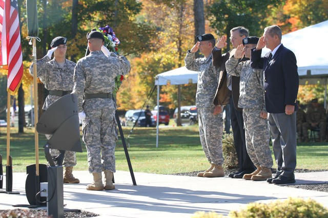 From center left, Maj. Gen. Stephen J. Townsend, Fort Drum and 10th Mountain Division (LI) commander; retired Brig. Gen. Bill David, former commander of 2nd Battalion, 14th Infantry Regiment; Command Sgt. Maj. Rick Merritt; and retired Command Sgt. Maj. Gerard Counts salute after the laying of the wreath for the fallen Battle of Mogadishu Soldiers during the Operation Restore Hope / Continue Hope memorial ceremony Thursday in Memorial Park. The ceremony marked the 20th anniversary of the Battle of Mogadishu in Somalia.