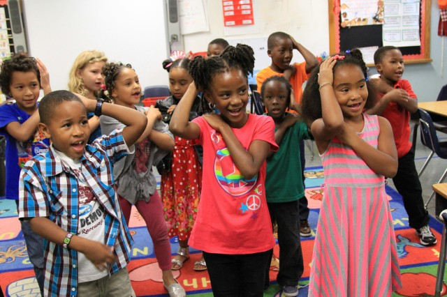 """Students perform the """"Macarena,"""" part of the school's """"Whole Brain Teaching"""" program during a visit by Soldiers assigned to 1st Battalion, 17th Field Artillery Regiment, 75th Fires Brigade Oct. 4 at Andrew Jackson Elementary School in Lawton. The Soldiers talked to the students about healthy living and exercising."""
