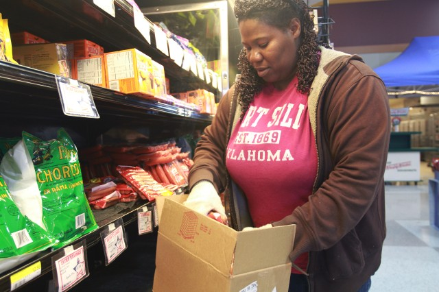 JoAnn Miles, vendor stocker, is busy stocking the Fort Sill Commissary Oct. 7 after the store closed Oct. 1. Miles said many items sold out on the last day the commissary was open, and she and the other stockers had a lot of work to do to get the shelves filled again.