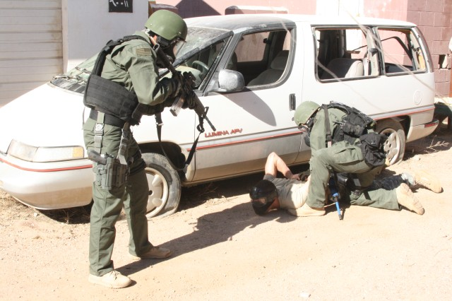 FORT CARSON, Colo. -- An escaped hostage taker is subdued by Fort Carson police at an exercise, Oct. 3.