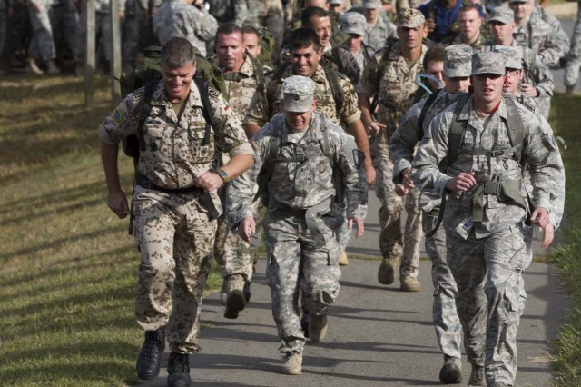Sergeant Major Sven Theede, IT-Info Security NCOIC, German Armed Forces Command United States and Canada, Bundeswehr, leads the foot march, the final event required to earn the German Armed Forces Badge for Military Proficiency, Reston Va.  (U. S. Army Photo by Cpt. Keith E. Thayer, First Army Division East, Public Affairs)