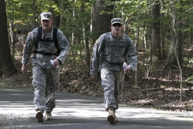 Cpt. Steven Lim, First Army Division East Intelligence office and Maj. Daniel Tower, First Army Division East operations office, push through one of the few flat stretches of the course during the final foot march event in Reston, Va.  The foot march is the culminating event required to earn the German Armed Forces Badge for Military Proficiency. (U. S. Army Photo by Cpt. Keith E. Thayer, First Army Division East, Public Affairs)