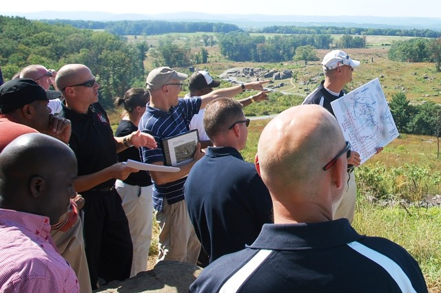 Leaders of the 174th Infantry Brigade discuss the terrain advantages associated with Big Round top and Little Round top during their professional development staff exercise at the Battle of Gettysburg National Park. (U.S. Army photo by Capt. Antonia Greene-Edwards, 174th Infantry Brigade Public Affairs)