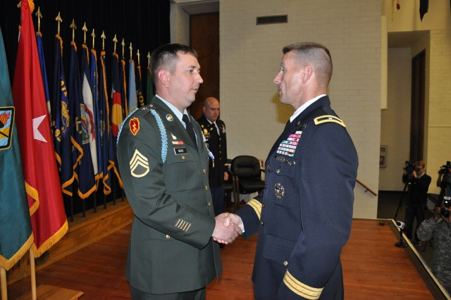 Staff Sgt. Gary Moore, left, Company B, 4th Battalion, 10th Infantry Regiment, received the Soldier's Medal from Brig. Gen. Bradley Becker, Fort Jackson's commanding general, at the Post Theater Wednesday. Moore was awarded the highest decoration for heroism not involving combat action for protecting a Soldier's life during a training incident in 2012.