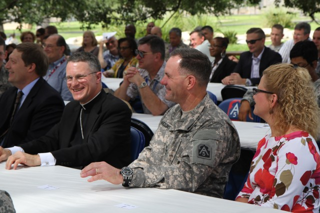 FORT SAM HOUSTON, Texas - Archbishop Timothy Broglio, head of the Archdiocese for the Military Services, USA, laughs with Lt. Gen. Perry Wiggins during the second annual U.S. Army North (Fifth Army), St. Michael medallion luncheon Sept. 27 at the historic Quadrangle. Broglio blessed the medallions before they were given to the guests. Wiggins is the commanding general for Army North and senior commander for Fort Sam Houston and Camp Bullis. (U.S. Army photo by Staff Sgt. Corey Baltos, Army North PAO)