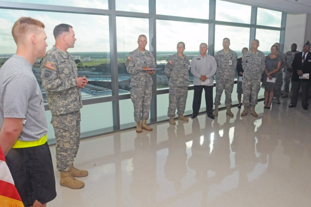 "FORT SAM HOUSTON, Texas - Lt. Gen. Perry Wiggins introduces Sgt. Shawn Murphy, the guest of honor, just prior to a Purple Heart presentation ceremony Oct. 3 at Brooke Army Medical Center. ""The humblest of Soldiers will say they were just in the wrong place at the wrong time,"" said Wiggins, about recipients of the highly respected medal. ""But, you are part of something bigger than yourself now."" Murphy is a combat engineer who was presented the medal after being wounded while serving in Afghanistan with the 62nd Engineer Company, 4th Engineer Battalion, and attached to the 307th Eng. Bn., under the 2nd Cavalry Regiment, out of Germany. Wiggins is the commanding general for U.S. Army North (Fifth Army) and senior commander for Fort Sam Houston and Camp Bullis. (U.S. Army photo by Sgt. 1st Class Christopher DeHart, Army North PAO)"