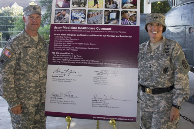 Maj. Gen. Jimmie Keenan (right), Southern Regional Medical Command commanding general, and Command Sgt. Maj. Jayme D. Johnson present the signed Army Medicine Healthcare Covenant, a formal covenant representing Army Medicine's commitment to provide quality care to Warriors and their Families, to the SRMC Soldiers and staff. U.S. Army photo by Diana L. Struski.