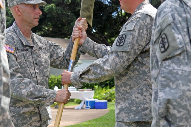 HONOLULU-- Capt. John Stehulak, the 124th Medical Detachment Commander, passes his cased guidon to the 18th Medical Command (Deployment Support) Commander Col. Bret T. Ackermann, during the 124th deactivation ceremony held at Fort DeRussy, Oct. 7.  The deactivation of the 124th Med. Det. was due to ongoing force realignment occurring throughout the U.S. Army. This unit provided optometry care throughout the local Hawaii garrison area of responsibility, Pacific Rim and combat areas during it's tenure under the 18th Medical Command (Deployment Support).  The 124th's guidon is safely stowed until the United States Medical Department needs her services again, said Col. Bret T. Ackermann, the 18th MEDCOM (DS) Commander. Then, the 124th will once again activate, uncase her guidon and deploy to wherever needed to execute her mission to standard. Thank you for your service and your leadership on this island, throughout the Pacific Rim, and in combat.