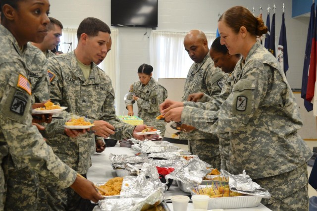 Soldiers of the 8th Theater Sustainment Command and subordinate units line up to sample a variety of Hispanic foods during the Hispanic Heritage celebration Oct. 2 at the Fort Shafter Flats. (U.S. Army photo by Spc. Erin Sherwood, 45th Sustainment Brigade Public Affairs)