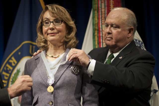 "Under Secretary of the Army Joseph W. Westphal presents the Army Decoration for Distinguished Civilian Service to former Rep. Gabrielle ""Gabby"" Giffords (Ariz.) for ""outstanding public service and support of the Army's missions,"" Oct. 10, 2013, at the Pentagon."