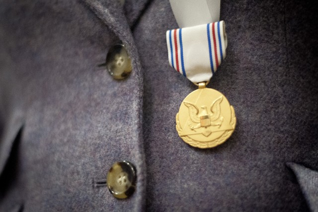 "Close-up photo of the Army Decoration for Distinguished Civilian Service that was just presented to former Rep. Gabrielle ""Gabby"" Giffords (Ariz.) for ""outstanding public service and support of the Army's missions,"" Oct. 10, 2013, at the Pentagon."