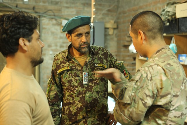 LAGHMAN PROVINCE, Afghanistan, (Oct. 10, 2013) - U.S. Army 1st Lt. Victor Acevedo, physician assistant with 3rd Squadron, 89th Cavalry Regiment, a native of Las Vegas, Nev., speaks with Dr. Hanif Jabarkhail, 6th Kandak provider for 2nd Brigade's, 201st Corps., about a soldiers foot at Nangalam base, Kunar province, Afghanistan, Sept. 10, 2013.  (U.S. Army photo by Spc Edward Bates/ Released).