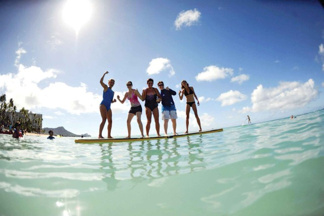Military spouses walk on water … actually, they balance atop a paddle board during the Joint Spouses' Conference, Oct. 5.