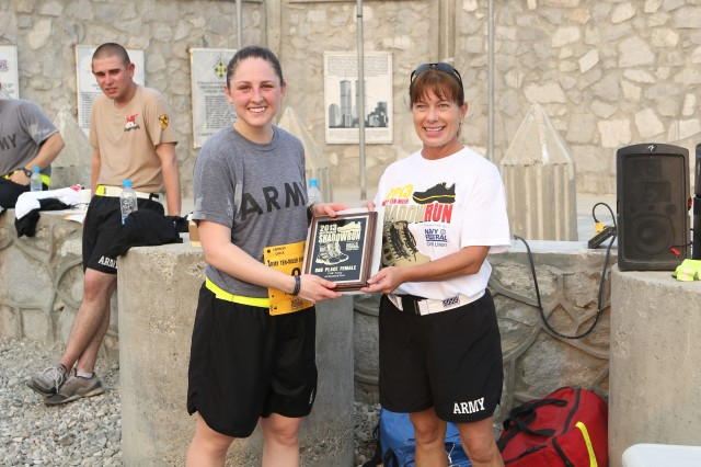 NANGARHAR PROVINCE, AFGHANISTAN(Oct. 9, 2013) - U.S. Army 1st Lt. Melanie Gouthro, Company B, 4th Brigade Special Troops Battalion, 4th Brigade Combat Team, 10th Mountain Division, receives a placard for the Army Ten-Miler shadow run at Forward Operating Base Fenty, Nangarhar province, Afghanistan, Oct. 9, 2013. Gouthro finished the 10-mile run in third place of the women's category, with a run time of 1 hour, 21 minutes. (U.S. Army photo by Spc. Vang Seng Thao / Released)
