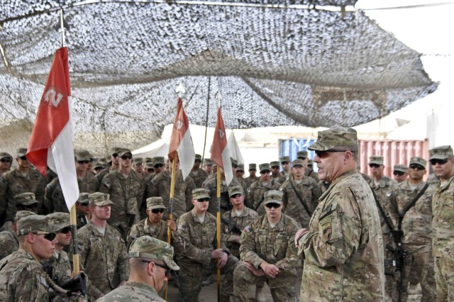KANDAHAR AIRFIELD, Afghanistan -- Lieutenant General Mark A. Milley, the commanding general of International Security Assistance Force Joint Command, speaks with Troopers of 1st Squadron, Combined Task Force Dragoon Oct. 10, 2013, at Forward Operating Base Zangabad, Afghanistan. Milley visited Soldiers and leaders of CTF Dragoon and presented awards to a number of them.