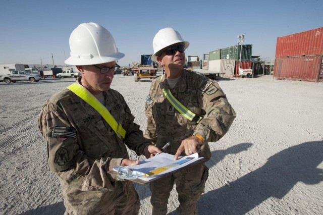 South Dakota Army National Guard Sgt. 1st Class John Kramer, 152nd Combat Sustainment Support Battalion, of Philip, S.D., and North Carolina Army Reserve Spc. David Bryan, 846th Transportation Company, of Aberdeen, N.C., verify numbers on the data plate of a container for the International database at Kandahar Airfield, Afghanistan, Oct. 9, 2013. The 152nd CSSB is working to not only sustain the four transportation units and the ordnance company they manage at Kandahar Airfield, they are also helping units in Regional Command-South drawdown equipment.