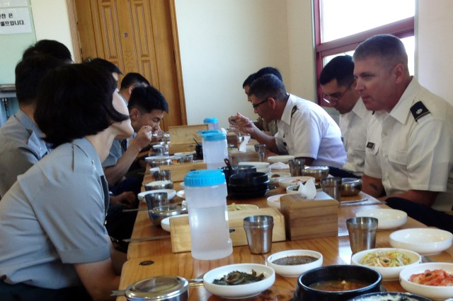 American and South Korean students in the first Korean National Defense University combined training course eat lunch at a Korean restaurant after a class trip to the Korean Demilitarized Zone.