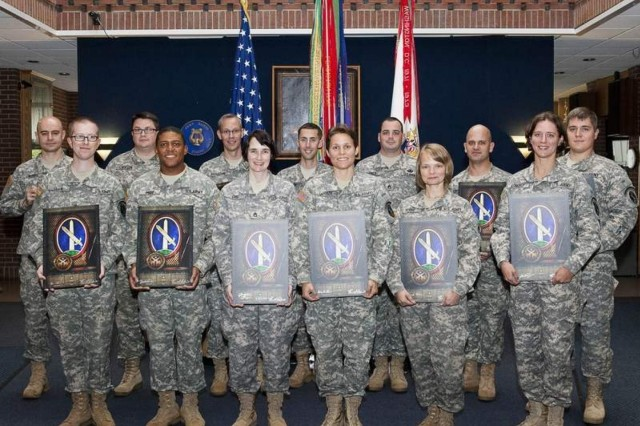"""Soldiers of the United States Army Band """"Pershing's Own"""" pose for a photograph after a mass reenlistment ceremony at Joint Base Myer-Henderson Hall's Brucker Hall Oct. 9."""